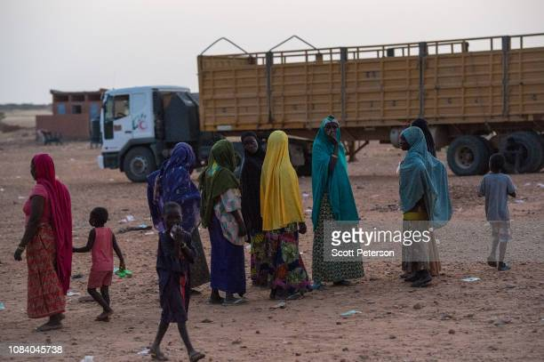 Women gather as a group of mostly Nigeriens arrive at dusk after a journey by truck across the Sahara Desert from Algeria victims of forcible...