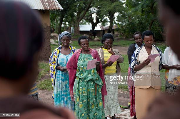 Women gather at a Community Microfinance Meeting in Bumweru Uganda Microfinance has become an important tool in developing countries by providing...