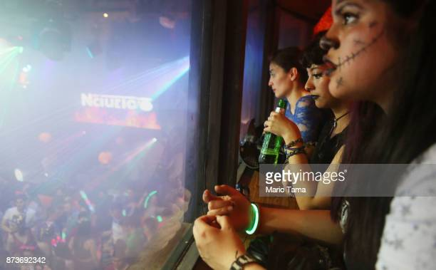 Women gather at a crowded nightclub in the early morning hours on November 5 2017 in Ushuaia Argentina Ushuaia is situated along the southern edge of...