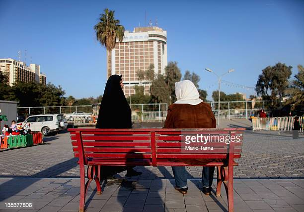 Women gather in front of the Ishtar Sheraton hotel on December 9 2011 in Baghdad Iraq The Ishtar Sheraton was popular with foreign media and...