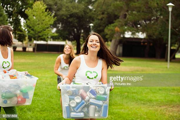 women gather recycling in park - women in transparent clothing stock photos and pictures