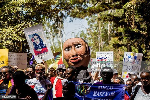 Women gather to support 'Women March' held against President Donald Trump in Washington at Karura Forest in Nairobi Kenya on January 21 2017