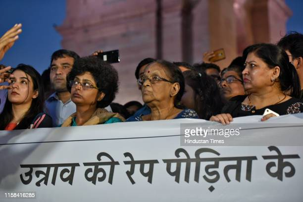 Women gathered for a silent protest in solidarity with the Unnao rape case victim, at India Gate on July 29, 2019 in New Delhi, India. The woman, who...