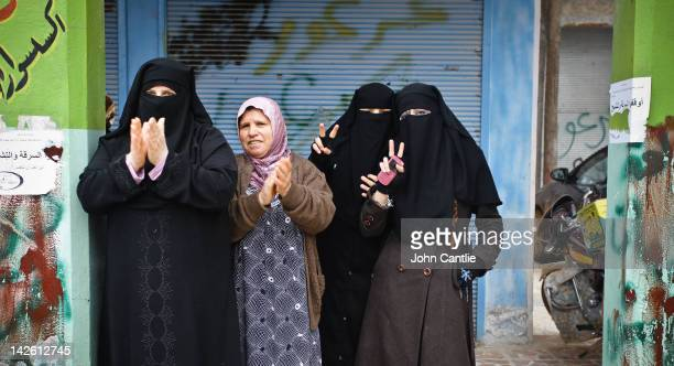 Women gesture during an antiAssad protest in the town of Binnish on April 9 2012 in Binnish Syria Conitnuing violence in northern Syria between...