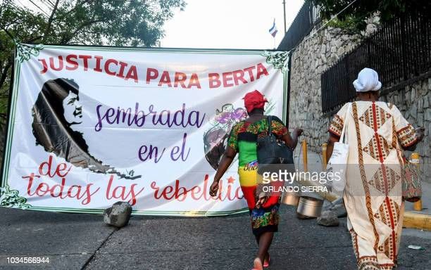Women get ready to take part in the vigil to demand justice in the indigenous environmentalist leader Berta Cacere's murder in front of the Supreme...
