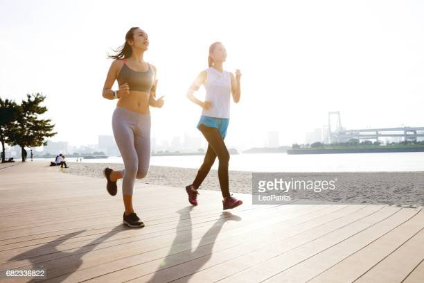 Women getting fit taking run afterwork in Tokyo