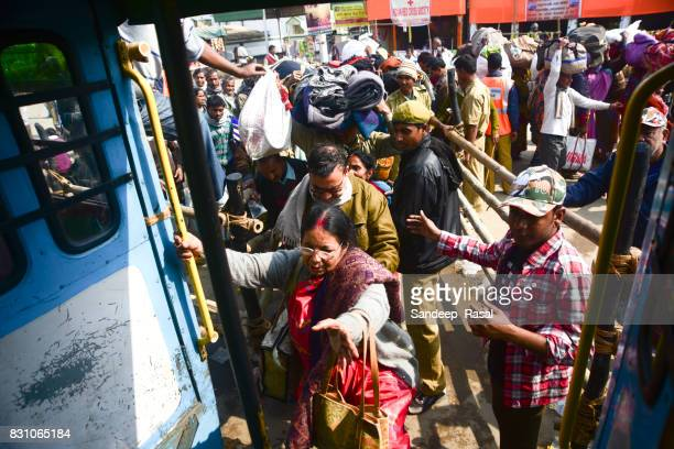 a women getting on a overcrowded bus during ganga sagar - ganga sagar stock photos and pictures