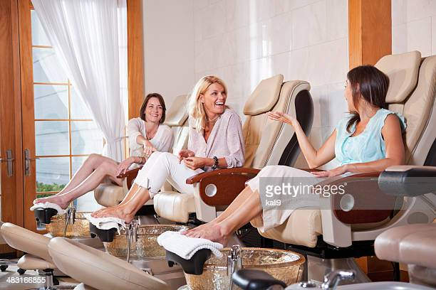 women getting pedicure - nail salon stock pictures, royalty-free photos & images