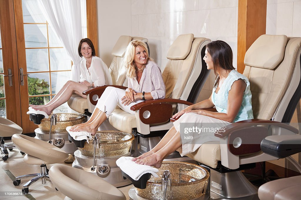 Women getting pedicures : Stock Photo