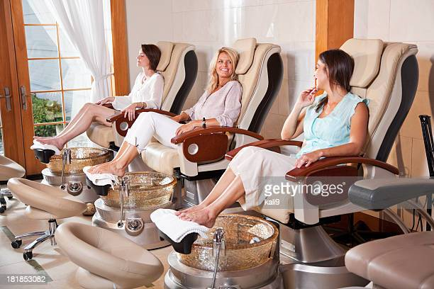 women getting pedicures - nail salon stock pictures, royalty-free photos & images