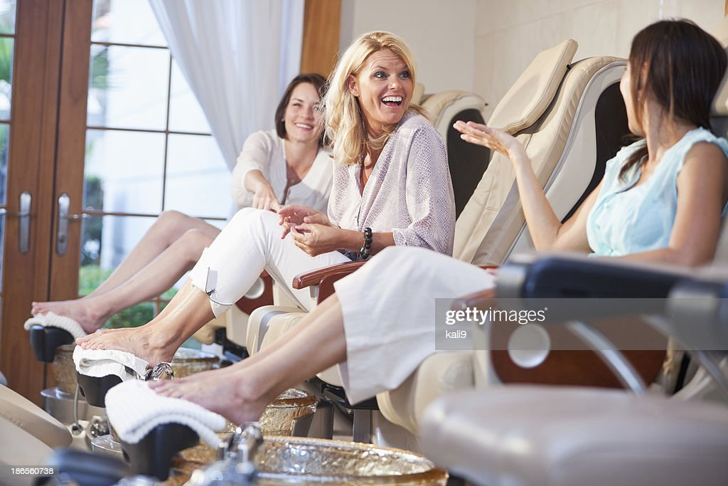Women getting pedicures : Stock Photo