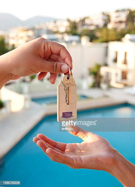 women gives hotel key - hotel key stock photos and pictures