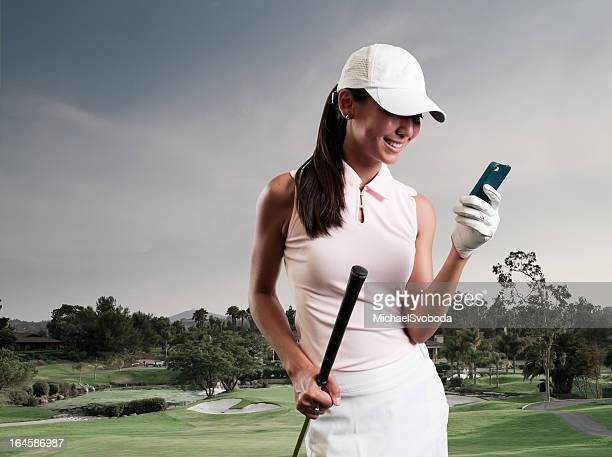 women golfer texting - golfer stock pictures, royalty-free photos & images