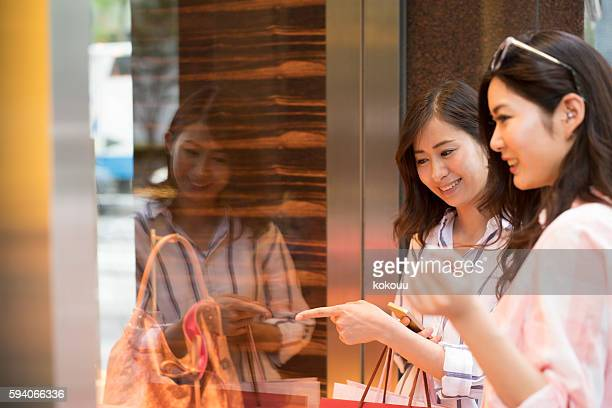 Women goods shops show window pointing finger