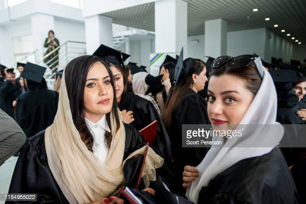 May 21: Women graduates celebrate after more than 100 Afghan students from the American University of Afghanistan receive their diplomas at a...