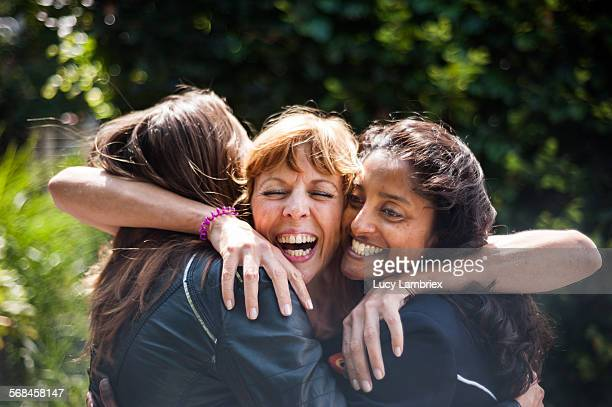 women greeting one another - wiedersehenstreffen stock-fotos und bilder