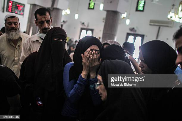Women grieve next to the body of a Morsi supporter who was killed at Rabaa Adaweya violent dispersal by security forces.