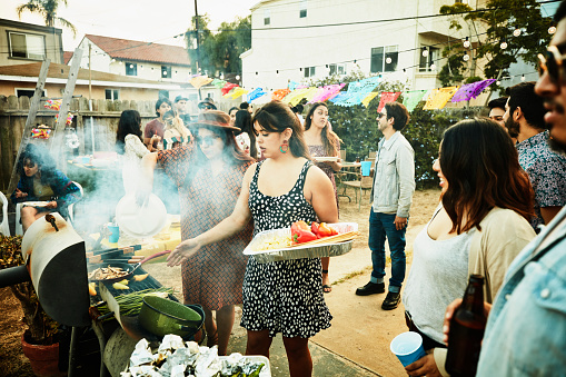 Women grilling food on barbecue during backyard party with friends - gettyimageskorea