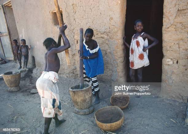 Women grinding grain in Mali circa 1965