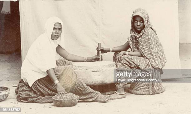 Women grinding grain There is no official date for this image India 1910