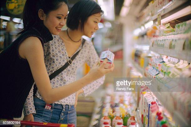 women grocery shopping - drinks carton stock pictures, royalty-free photos & images