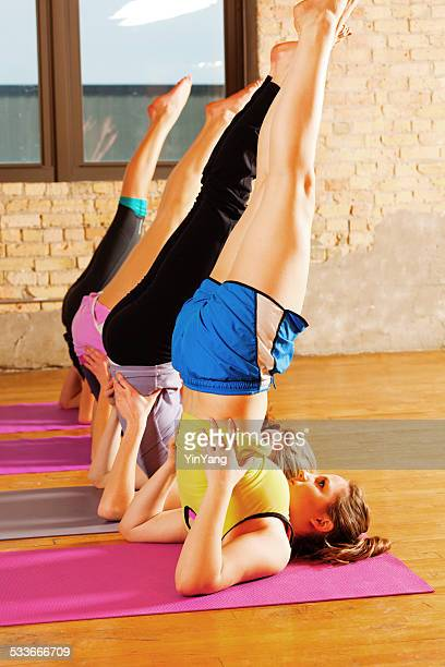 women group training in yoga and exercise class in health center - teen ass stock photos and pictures