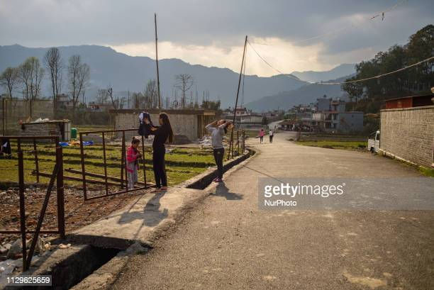 Women hang clothes for drying on the outskirts of Pokhara Nepal in March 2019