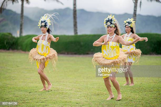 women happily performing at a luau - polynesian culture stock photos and pictures