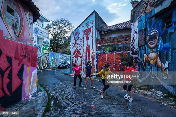 Women have a kickabout on a Sao Paulo city sreet