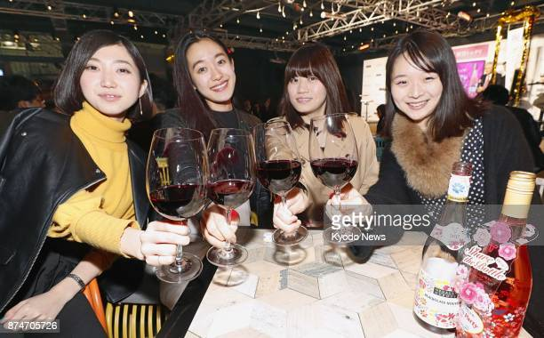 Women have a toast before drinking justreleased Beaujolais Nouveau wine in Tokyo on Nov 16 2017 ==Kyodo