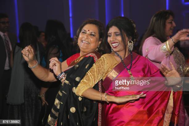 Women have fun and dance the night away to classic Bollywood songs during the Langar Seva fundraising gala in Mississauga Ontario Canada on 17...