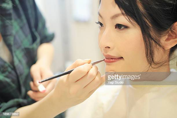 Women have make-up by stylist