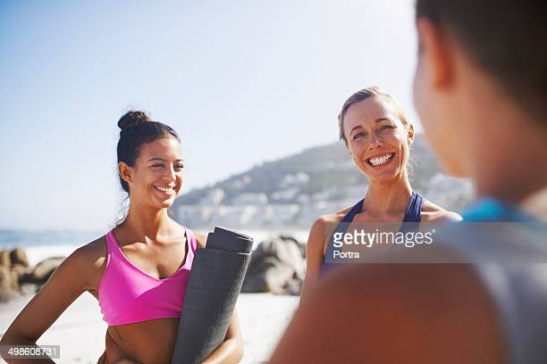 Women having a conversation after yoga class