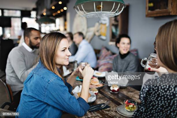 Women having brunch with friends at table