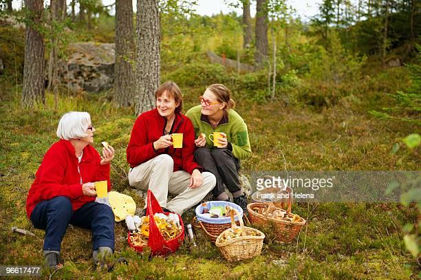 Women having coffee break in forest