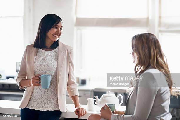 Women having coffee in kitchen