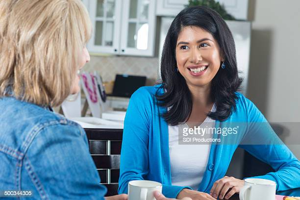 women having coffee together during home jewelry sales party - female friendship stock pictures, royalty-free photos & images