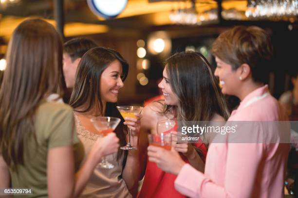 Women having drinks at a bar