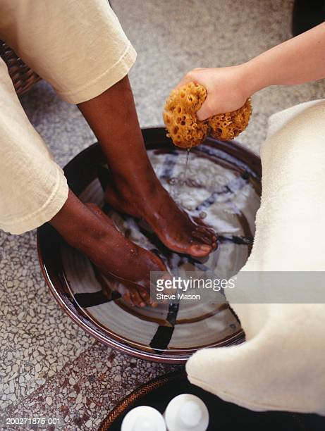 women having feet washed in beauty parlour, low section, elevated view - black pedicure stock photos and pictures