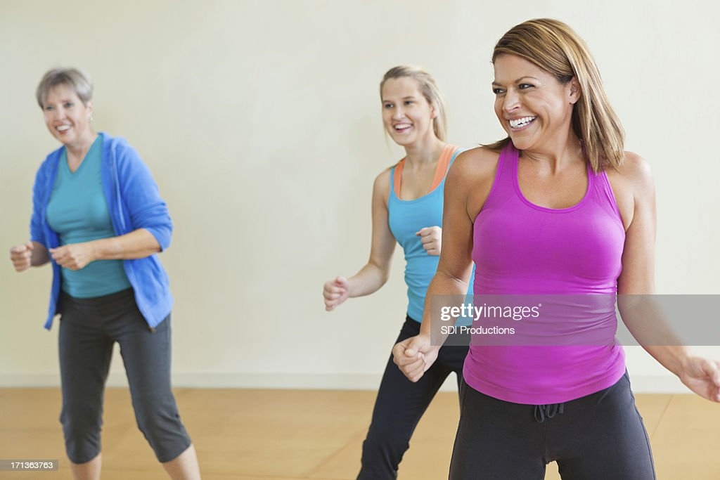 Women having fun together in fitness exercise class : Stock Photo
