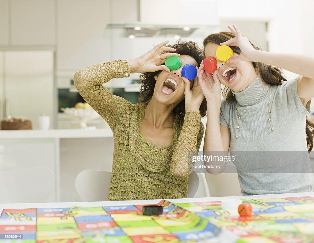 Women having fun with board game : Stock Photo