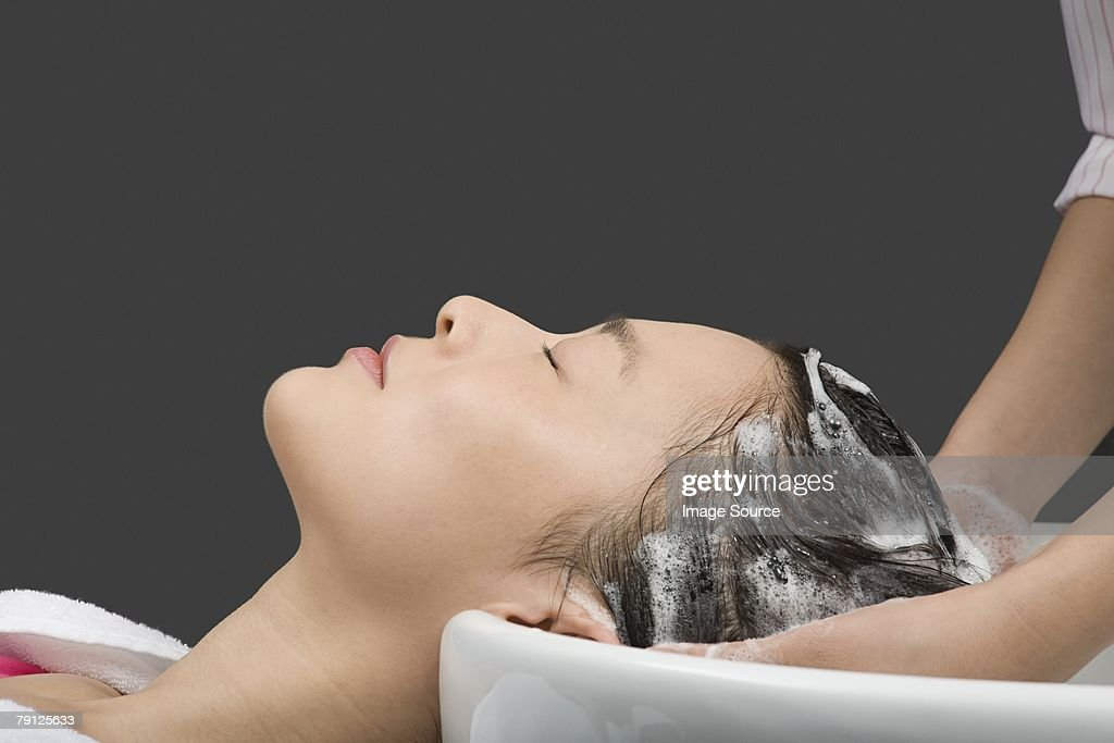 Women having her hair washed : Stock Photo