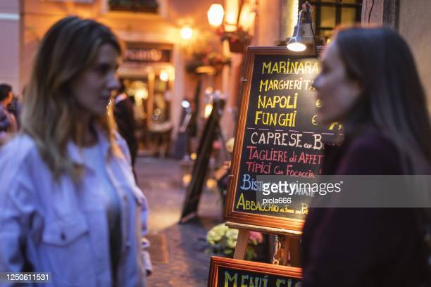 women having italian aperitivo together in rome - happy hour stock pictures, royalty-free photos & images