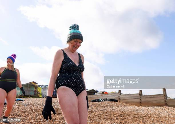 women head to the sea for open water swimming - mature women stock pictures, royalty-free photos & images