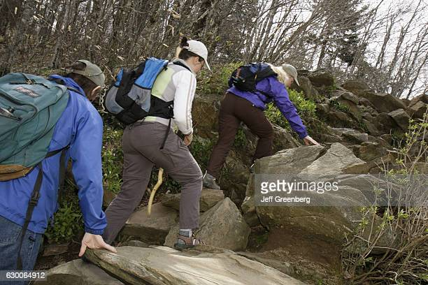 Women hiking up rocks at Newfound Gap