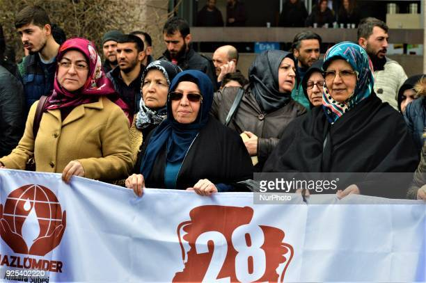 Women hold a banner as an organized group of proIslamic demonstrators makes a statement outside the main courthouse on the 21th anniversary of...