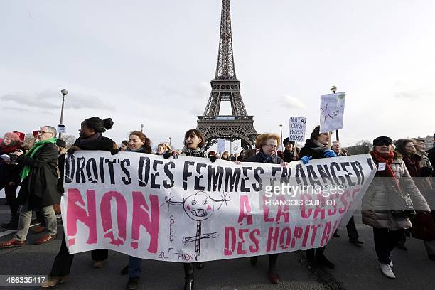 Women hold a banner reading 'Women's rights in danger' during a demonstration in Paris on February 1 to protest against a Spanish legislation yet to...