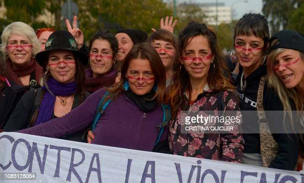 Women hold a placard reading Against sexist violence during a Women's demonstration against the farright party VOX on January 15 2019 in front of...