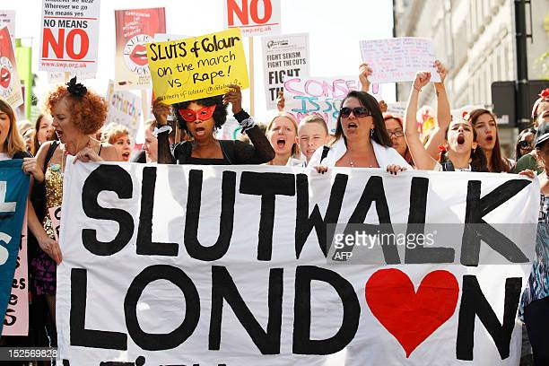 Women hold banners and shout slogans as they take part in a 'slut walk' in London on September 22 2012 to protest against the police and courts'...