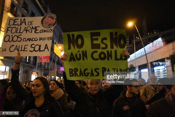 Women hold banners as they take part in a protest in Barcelona during the International Day for the Elimination of Violence against Women